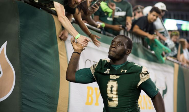 USF QB Quinton Flowers high fiving fans post-game vs. NIU SNAP