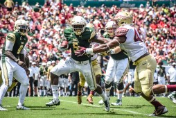 FSU vs USF 2016 75 - Marlon Mack stiff arms Demarcus Walker Quinton Flowers watching by Dennis Akers (4512x3008)