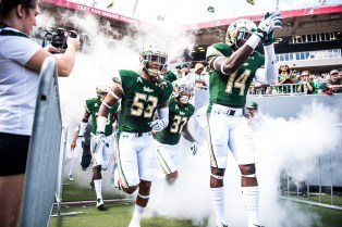 25 USF vs ECU 2016 - USF WR Deangelo Antoine LB Danny Thomas and DB Nate Ferguson exiting the tunnel 2 (6016x4016)