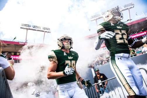 31 USF vs ECU 2016 - USF S Hassan Childs and CB Nick Cuccia exiting the tunnel (6016x4016)