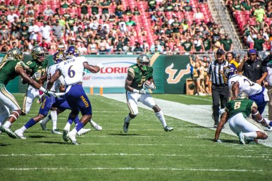 42 USF vs ECU 2016 - USF RB Marlon Mack rushes up field with WR Tyre McCants blocking ECU SS DaShawn Benton (5785x3862)