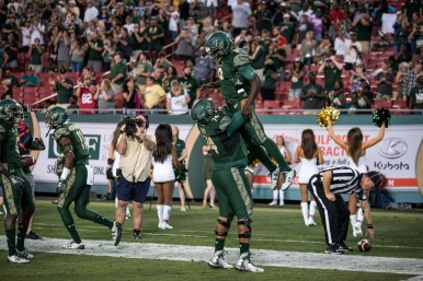 48 - Navy vs. USF 2016 - USF QB Quinton Flowers TD run celebration with Cameron Ruff by Dennis Akers | SoFloBulls.com (5832x3893)