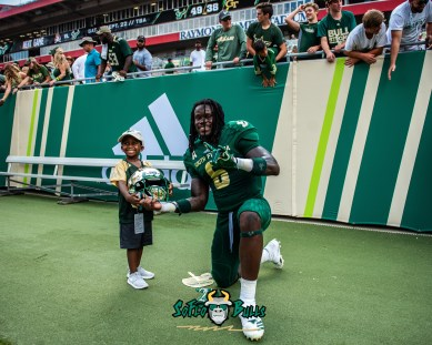 165 - Georgia Tech vs. USF 2018 - USF DB Deangelo Antoine smiles with a child after the game by Dennis Akers | SoFloBulls.com (4894x3915)