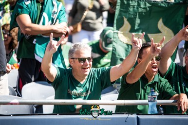 49 - USF vs. Illinois 2018 - USF Fan In Crowd Horns Up at Soldier Field by Dennis Akers | SoFloBulls.com (5373x3587)