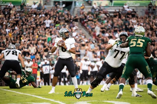 61 - UCF vs. USF 2018 - UCF QB Darriel Mack Jr looks to pass with Josh Black in pursuit by Dennis Akers | SoFloBulls.com