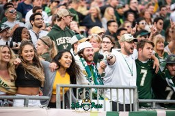 96 - Tulane vs. USF 2018 - Greg '3rd Leg Greg' Wolf in stands with USF Students at Raymond James Stadium by Dennis Akers