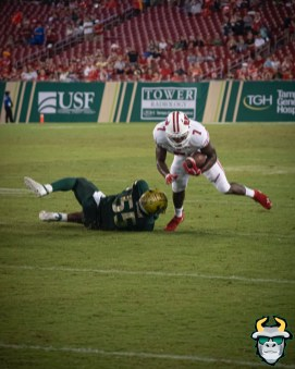 123 - Wisconsin vs USF 2019 - USF LB Patrick Macon tackling Bradrick Shaw by David Gold - DRG06814