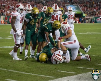 48 – Wisconsin vs USF 2019 – USF DB McArthur Burnett tackles Aron Cruickshank Antonio Grier by David Gold – DRG05338