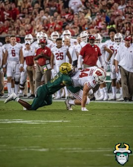 51 – Wisconsin vs USF 2019 – USF DB Devin Studstill tackles John Chenal by David Gold – DRG05407