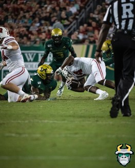 55 – Wisconsin vs USF 2019 – USF DB Vincent Davis tackles Jordan DiBenedetto by David Gold – DRG05535