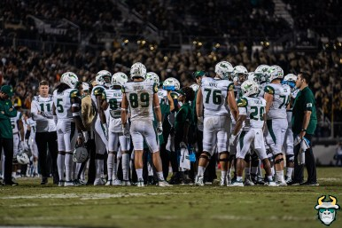 90 - USF vs. UCF 2019 - Mitchell Wilcox with team on field at Spectrum Stadium by David Gold - DRG06770