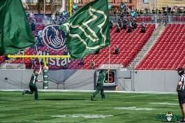 16 - USF Spring Game 2021 Cheerleaders Running with Flag at Raymond James Stadium DRG06086