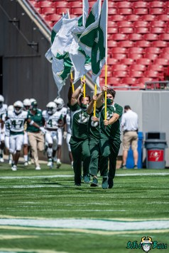 17 - USF Spring Game 2021 Cheerleaders Running with Flag at Raymond James Stadium DRG06100