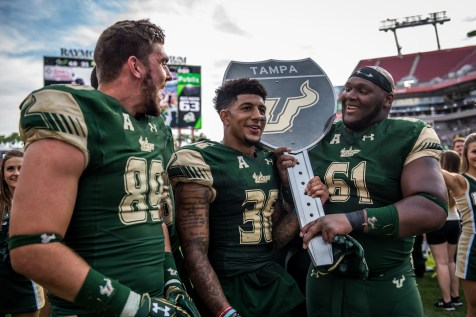 101 - USF vs. UCF 2016 - USF S Nate Godwin TE Mitchell Wilcox OL Dominique Threatt holding #WarOnI4 Trophy by Dennis Akers | SoFloBulls.com (5791x3866)