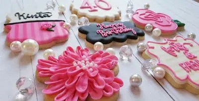 Pastel and hot pink adorned 40th birthday cookies