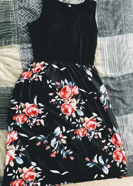 Black bodice on sleeveless maxi dress with roses on skirt