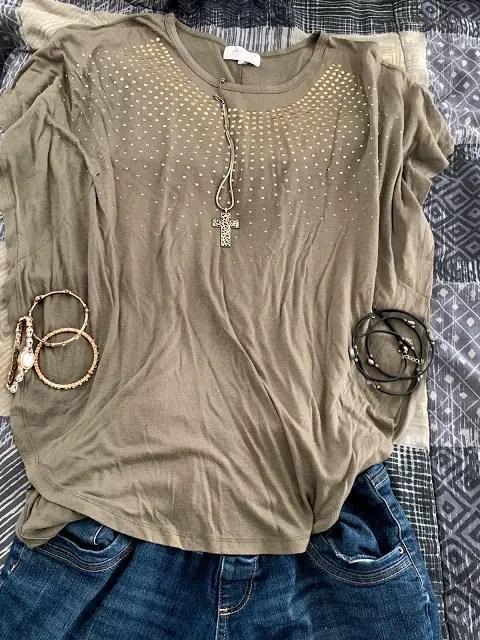 Khaki shirt with denim jeans, gold watch and bracelets