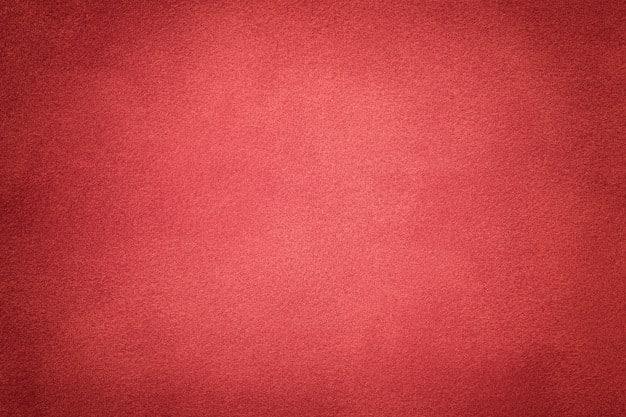 Background of dark red suede fabric closeup. velvet matte texture Premium Photo