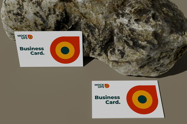 Top view business card mockup on rock Premium Psd