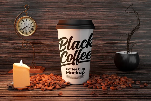 White coffee cup mockup with candle and coffee bean decorations Premium Psd