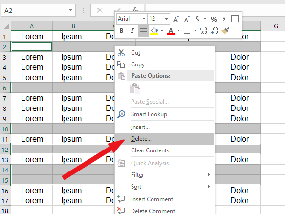 right-click on one of the blank cells and click on delete
