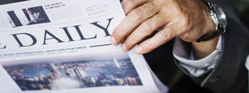 Image of a person reading a newspaper