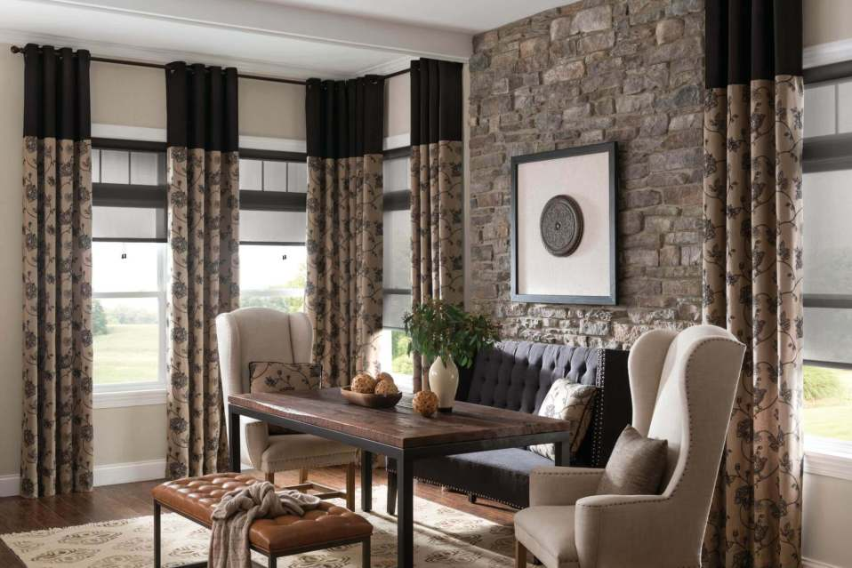 Two-tone solid and pattern custom draperies combined with other window treatments for a look that ties everything together.