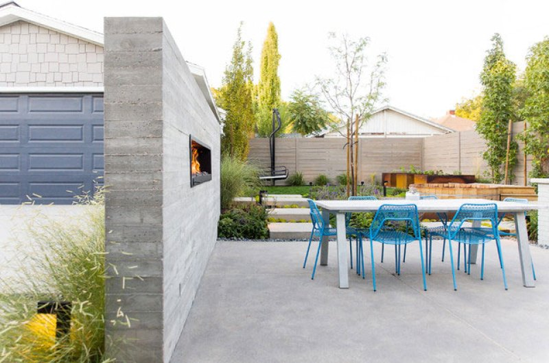 Concrete wall serves as landscaping screen