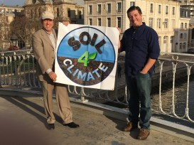 Seth Itzkan and Chris Kerston with Soil4Climate Sign in Paris