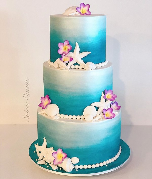 handpainted beach cake with frangipani