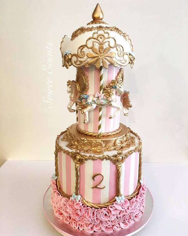 pink and white single tier carousel cake