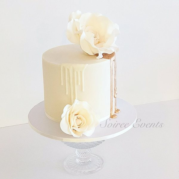 gold dripcake and sugar flowers