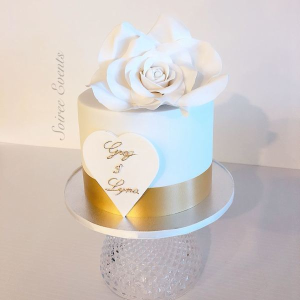 simple white and gold sugar rose cake