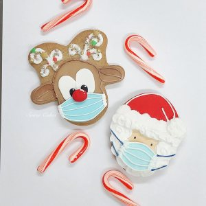 masked santa and rudolph covid gingerbread cookies