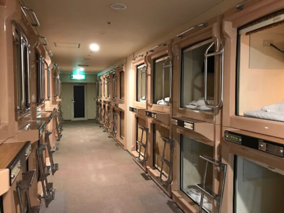 A Capsule Hotel in Osaka features over 100,000 manga, sauna, and a VR experience