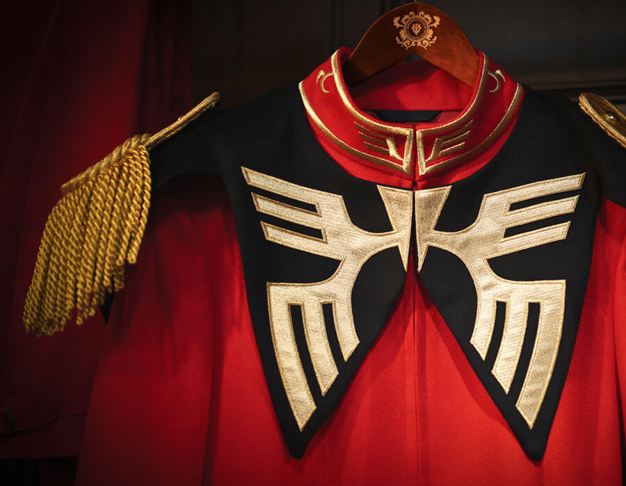 The Queen of England's tailors just recreated Char Aznable's Zeon uniform