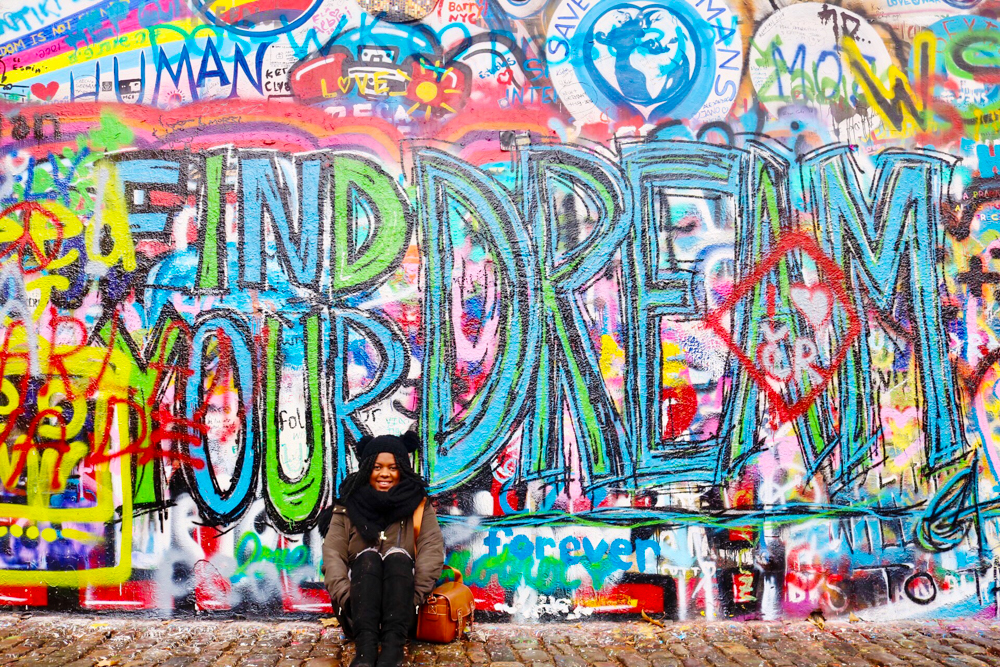 "The John Lennon Wall in Prague that says ""Find your dream"""