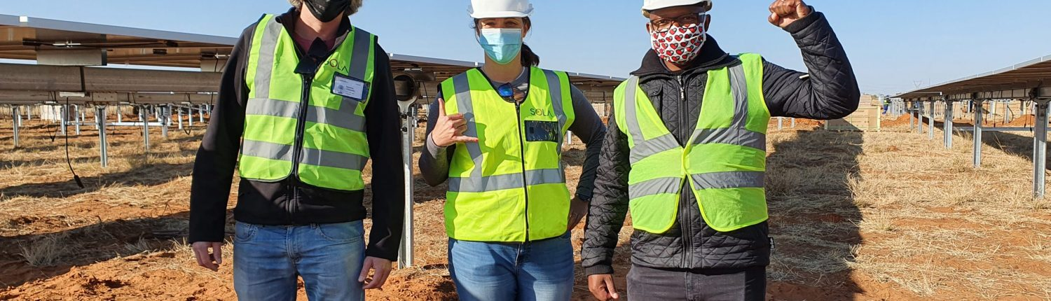 SOLA head of Project Development, Katherine Persson, visits a solar project.