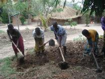 People earn ovens and lamps by building houses, digging latrines, farm labor and carrying wood and water.