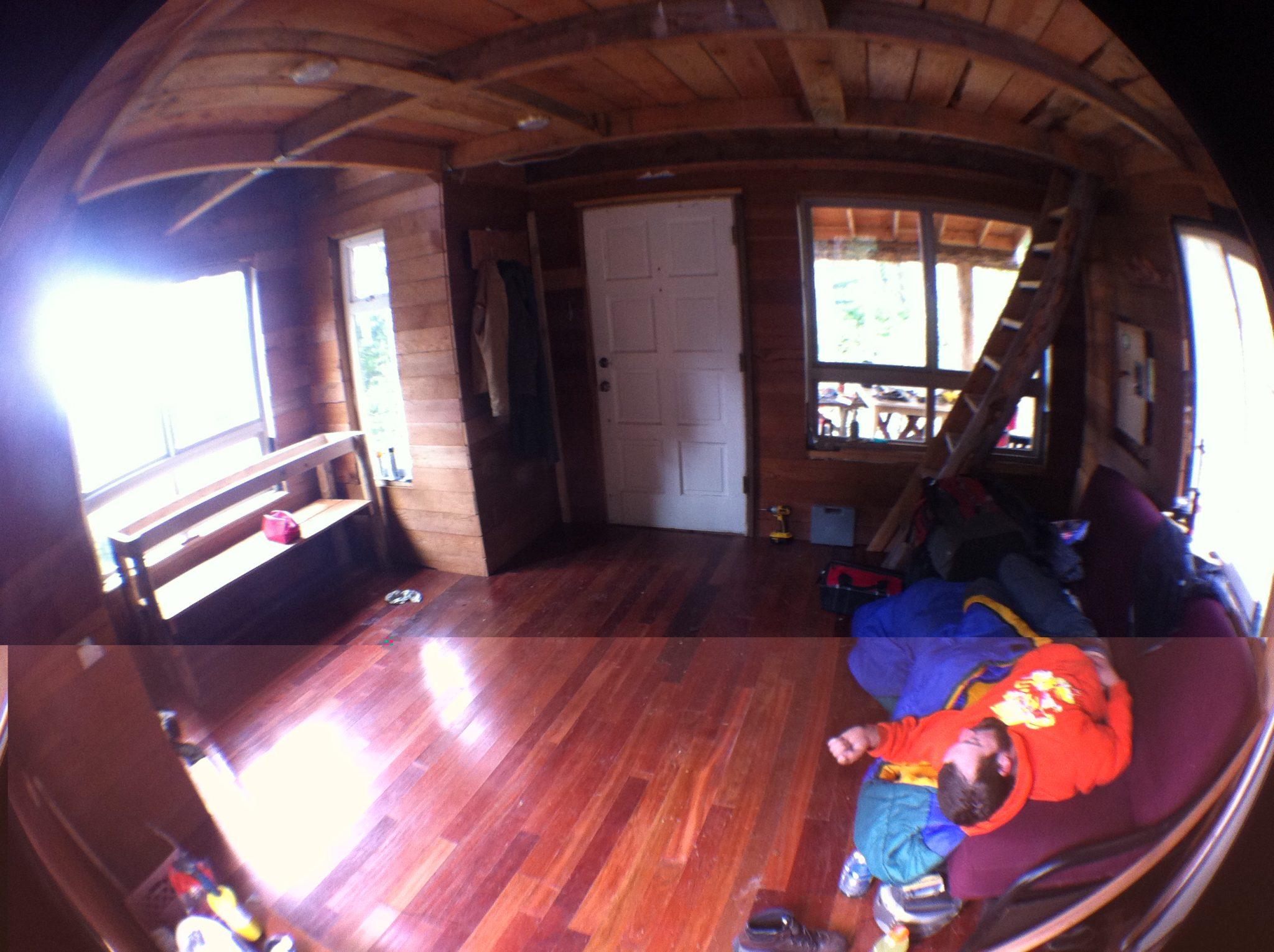 Wood floor in tiny cabin