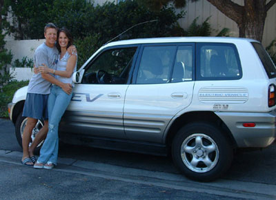 Picture of Ian Murray and Alexandra Paul in front of a Toyota Rav4 EV