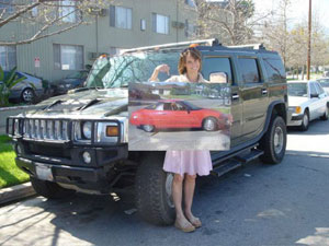 Alexandra Paul poses in front of a GM Hummer.