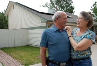 neighbor-solar-couple-hug
