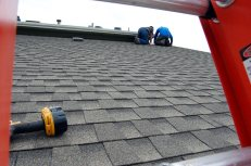 """A """"ladder's eye"""" photo of our roof catches Joel (left) and Tim (right) measuring out, and chalking up, our roof."""