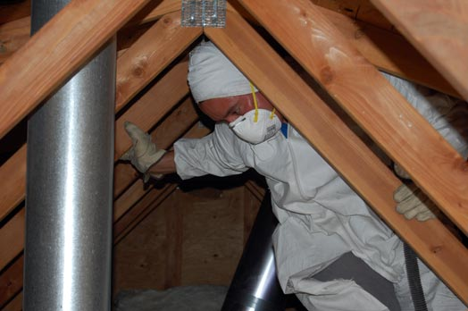 Dustin makes his way through our hot, tight and difficult-to-manuever-in attic while scoping out a route for the system's electrical wiring.