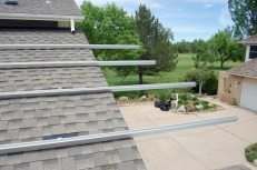 Railing hangs off our roof. Tim later cut the excess railing.