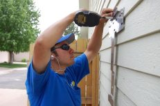 Dustin installs the wall mount for the system's SMA Sunny Boy Solar Inverter at about 2 p.m. on Day 1.