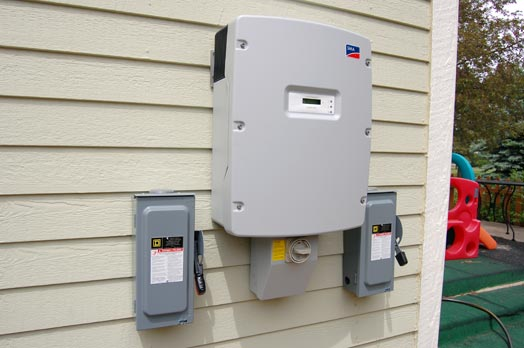 The SMA Sunny Boy 6000 Inverter (center) is up, as are the required disconnect boxes (AC, DC and PV).