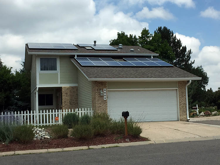 A home solar system on top of a house in Aurora, Colo.
