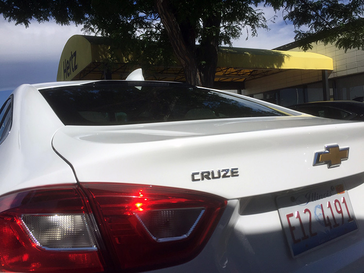 A gas car rental -- a Chevy Cruze -- parked at Hertz in Englewood, Colo.